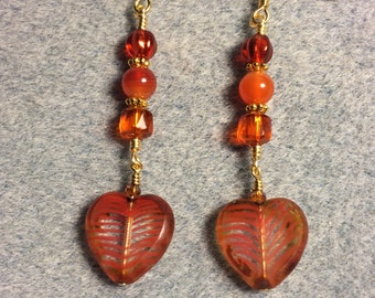 Orange striped Czech glass heart bead dangle earrings adorned with orange Czech glass beads.