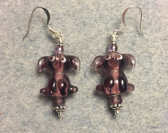 Translucent violet lampwork sitting elephant bead earrings adorned with violet Czech glass beads.
