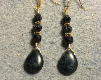Black Picasso Czech glass briolette earrings adorned with black Picasso Czech glass beads.