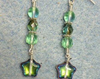 Light green metallic Czech glass star dangle earrings adorned with light green Czech glass beads.