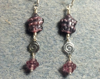 Violet marbled Czech glass turtle bead dangle earrings adorned with silver swirly connectors and violet Saturn beads.