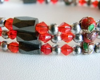 Magnetic Red Crystal Colored Silver Tone Accents and Baubles  Bracelet
