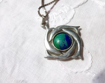 Dolphin and Earth pendant