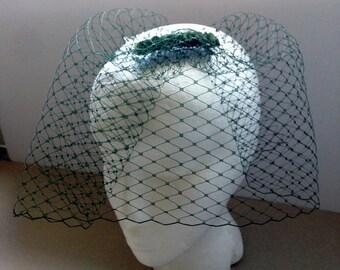 Dark green birdcage veil