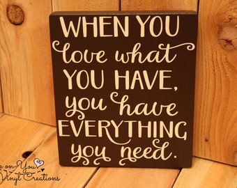 When you love what you have, you have everything you need hanging wood sign