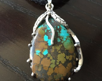 Spiderweb Turquoise Pendant set in 925 Sterling Silver.