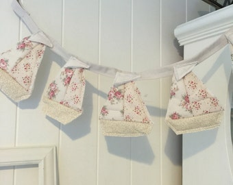 Pretty quilted boat bunting in pale pinks and cream
