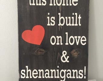 """Custom painted wooden sign""""This Home is Built on Love and Shenanigans""""  11"""" x 15"""""""