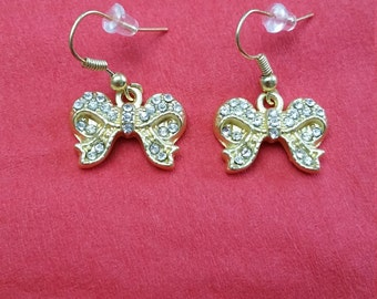Gold Bow Shaped Pierced Earrings with Clear Rhinestones