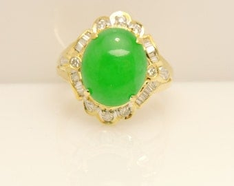 Lady's Yellow 18 Karat Ring Size 7.5 With One  Oval Green Jade And 24= Various Shapes Diamonds