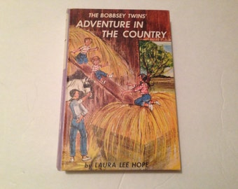 """The Bobbsey Twins' """"Adventure in the Country"""" in hardcover by Laura Lee Hope. 1961. #504"""