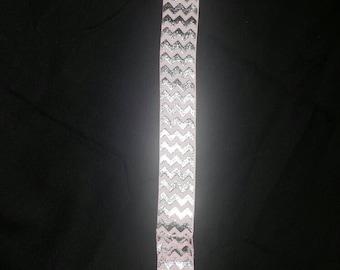 Pink zig zag pacifier clip