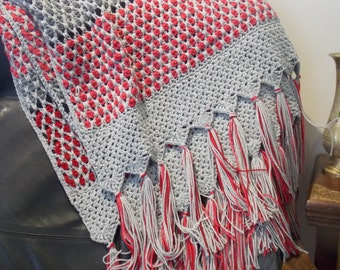 Marrakesh crochet blanket, using Moroccan Tile stitch in lush shades of cherry, scarlet, and magenta contrasted with dark and silver grey.