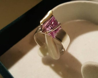 Silver ring with cubic zirconia in violet tone
