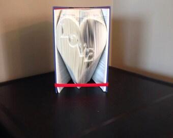 Book folding art pattern for Love inside a heart