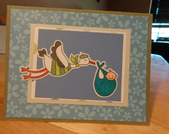 Stork delivering a baby card