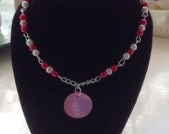 Pink bead necklace with a pink mother of pearl shell