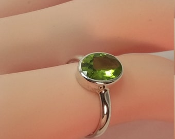 Peridot ring set in sterling silver, free shipping,view link to purchase resizing below in item details