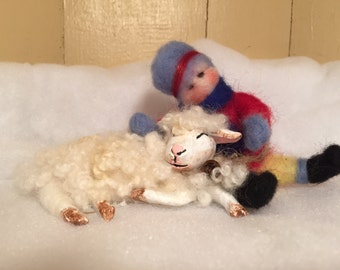 Wool felted sheep and child