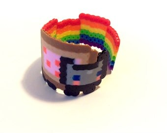 Nyan Cat Plastic Cuff - Pop Culture Jewelry - Poptart Cat Bracelet - Geeky Gift - Nerdy Jewelry - Fun Kids Wristband