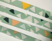 """Colorful Triangles on Soft Green Art Gallery Fabrics """"Mojave in Aloe"""" Double Fold Bias Tape - 3 yards, 1/2"""" wide"""
