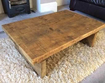 Rustic handcrafted reclaimed wooden coffee table in oak wax.