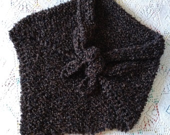 This is a warm and cozy hand knit shawl.