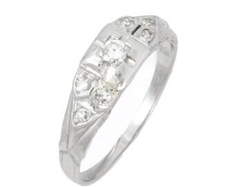 Vintage 0.15 carat old European cut diamond and platinum engagement ring. Circa 1930.