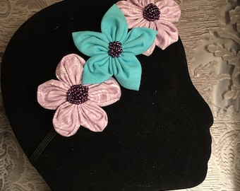 Large floral headband with beaded accents