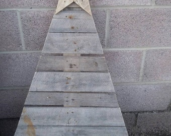 Christmas tree and star made from 100% reclaimed pallet wood.
