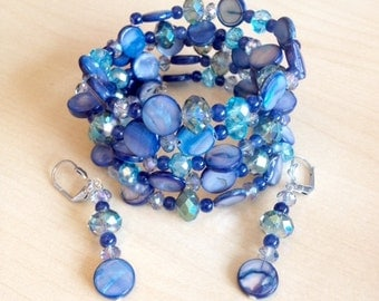 Blue cuff bracelet and earrings with shell pearl and faceted glass beads