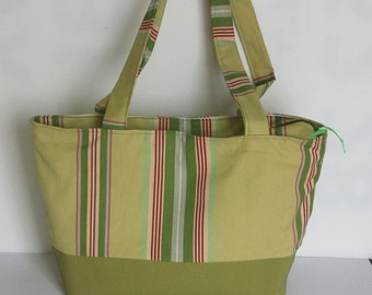 Shopping bag in green color and multicolor fabric