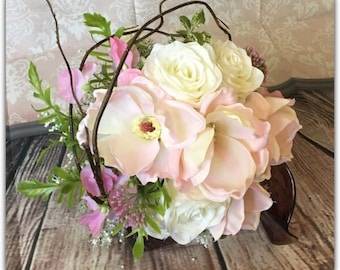 Magnolia bridal bouquet. Pink wedding bouquet.
