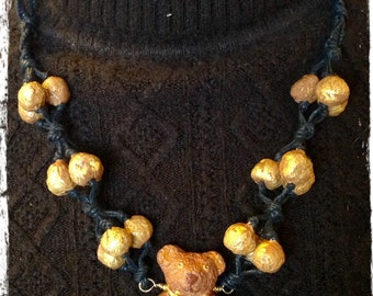 Handmade necklace with teddy bear.