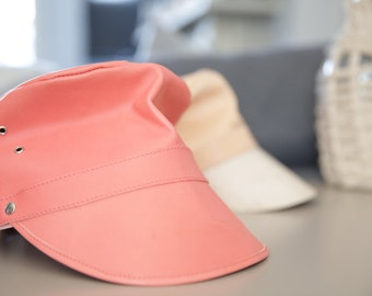 Leather cap in coral colour