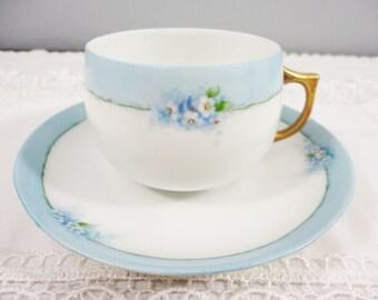 Rare Antique Jaeger & Co. German Hand Painted Blue Floral Porcelain Teacup and Saucer