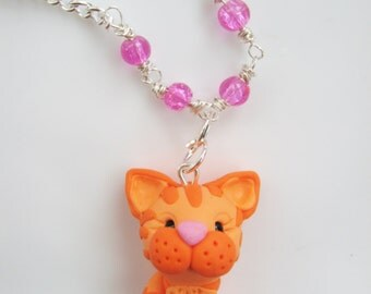 Orange cat with magenta heart-necklace,polymer clay,beads