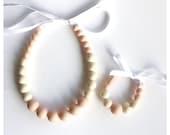 Infant necklace and bracelet set