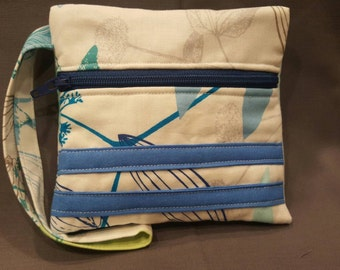 Handmade wristlet made with blue floral summery material