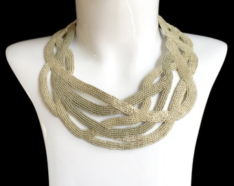 Entwined. Bead Embroidered neck piece .