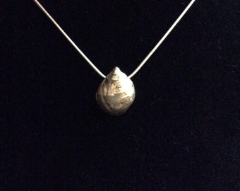 Solid silver shell pendant