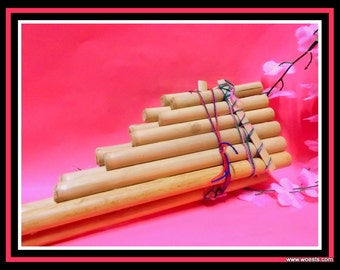 Vintage panpipe / panflute musical instrument. Fluted made of bamboo wood.