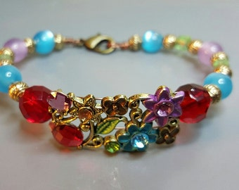 Beautiful Flower Bracelet made with cat eye glass beads and red czech faceted beads.Great Gift!