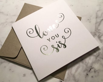 Love you Sis / Sister - Silver foiled greeting card with envelope