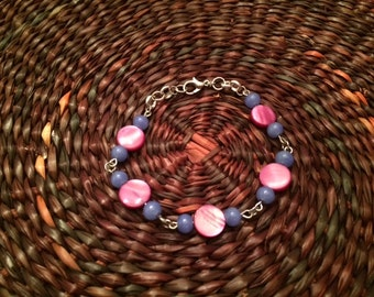 Pink rounds with blue bead bracelet