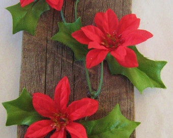 Red Poinsettias on a picket