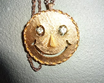 Smiley face goldtone necklace