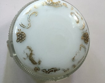 Antique milk glass vanity jar,  1930, lid rests inside top of jar, fair condition, gilt trim rubbed off in areas
