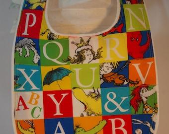 Bib terry cloth snap closure Dr. Suess alphabet on white terry