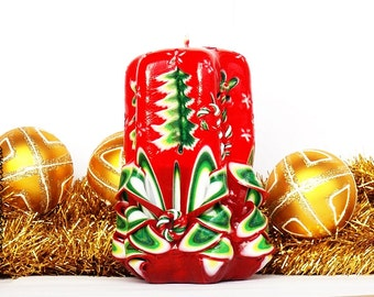 carved candles - red green was a gift for the new year - Christmas Trees at the festival